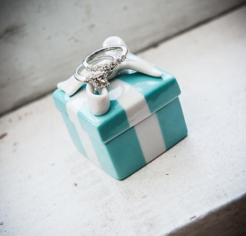My engagement ring and wedding ring with a porcelain Tiffany box