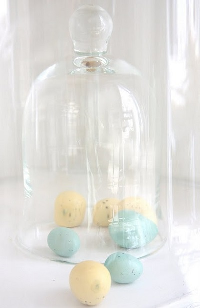 colored eggs under glass dome
